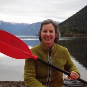 Joan Fessenden, Certified Clinical Herbalist sitting in a canoe on a lake